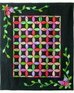 This is the first of many quilts made with my new tool:  Leaves Galore!