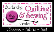 Sturbridge Quilting and Sewing Center logo