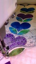 Linda Gosselin quilting using the Leaves Galore template